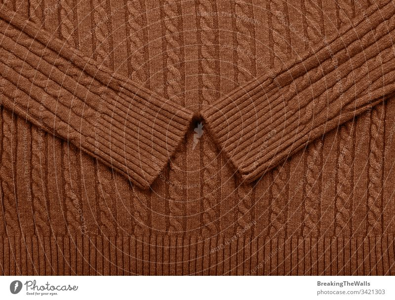 Background texture of brown knitted wool fabric Knitware dark vivid background pattern cable sweater braid tricot knitting jersey hosiery textile wear warm
