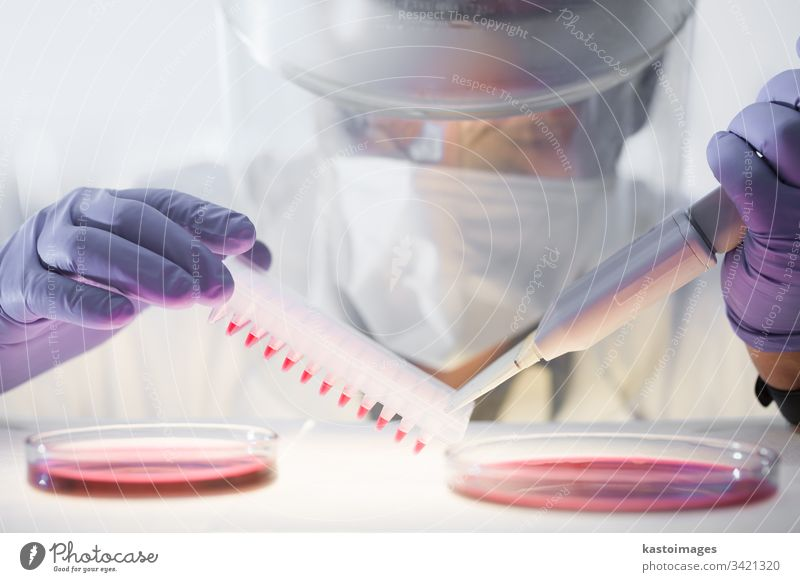 Scientist working in the corona virus vaccine development laboratory research with a highest degree of protection gear. science scientist COVID-19 analysis