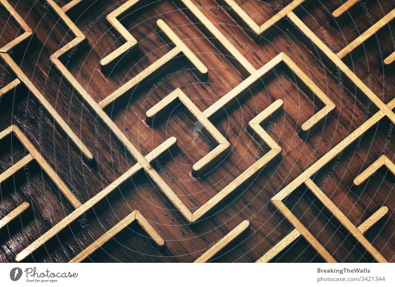 Wooden brown labyrinth maze puzzle close up Labyrinth toy wooden closeup elevated high angle view complex way find think game metaphor concept background route
