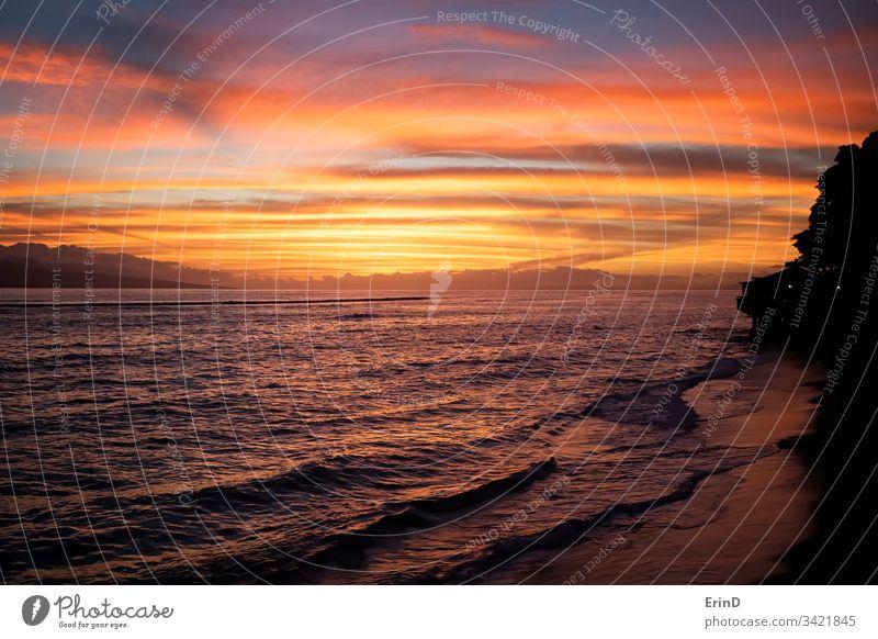 Sunset over Ocean and Coastline sunset ocean seascape landscape bright colorful vibrant Hawaii coast coastline island orange purple water blue travel vacation