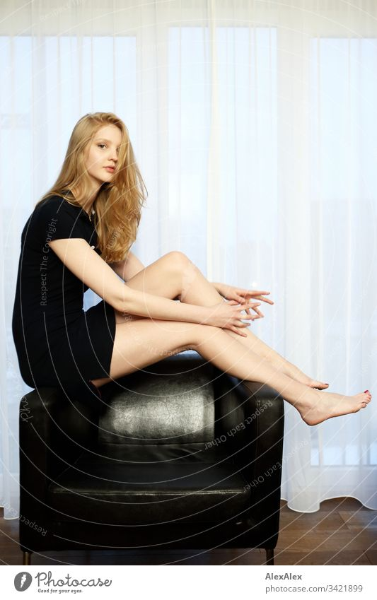 Portrait of a young woman on an armchair Slim Elegant Style Beautiful Life Flat (apartment) Room Young woman Youth (Young adults) Face 18 - 30 years Adults