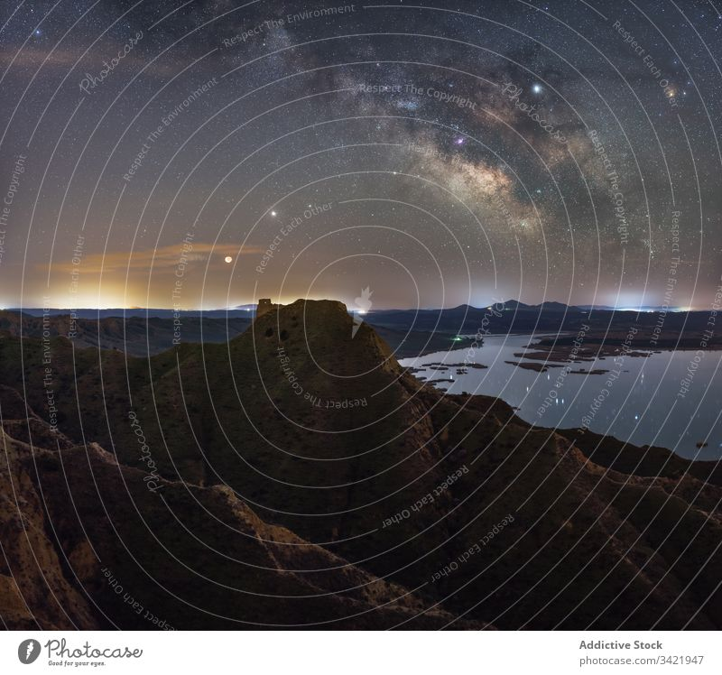 Summer bright night in rocky terrain nature landscape sky mountain panorama star milky way hill top peak tourism evening adventure cliff travel tranquil