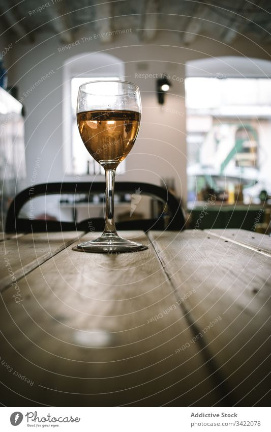 Glass of wine on wooden table glass rustic wineglass drink alcohol bar restaurant beverage liquid pub transparent tradition glassware golden counter service