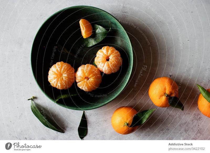 Fresh mandarins fruits on table tangerine citrus fresh orange natural peel leaf bowl food tasty delicious juice organic healthy sweet ripe vitamin vegetarian