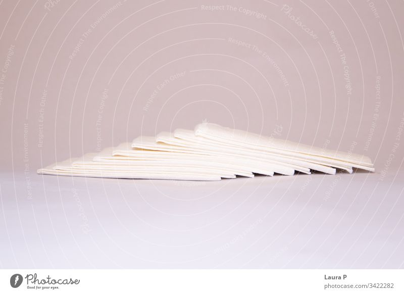 Stack of napkins on a soft pink background angle decoration heap table pack cleanliness hygienic fresh facial object blank pile pattern handkerchief stack