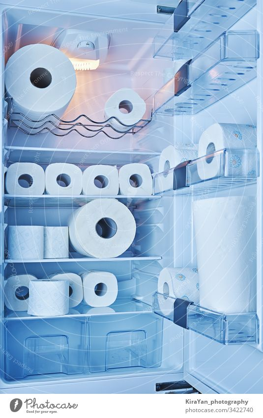 Fully filled toilet paper fridge. Panic buying toilet paper in all countries during spread of COVID-19 coronavirus covid-19 refrigerator kitchen household prank