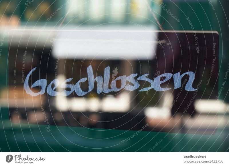 sign geschlossen meaning closed in german shop store shut germany business corona coronavirus lockdown economy bankruptcy window glass door entrance concept