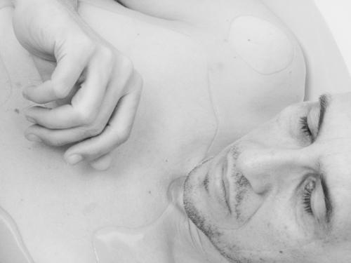 Gently the warm bath water embraced the sleeping man. Man bathe Sleep Head Face Hand Black & white photo Interior shot Dream Portrait photograph Calm