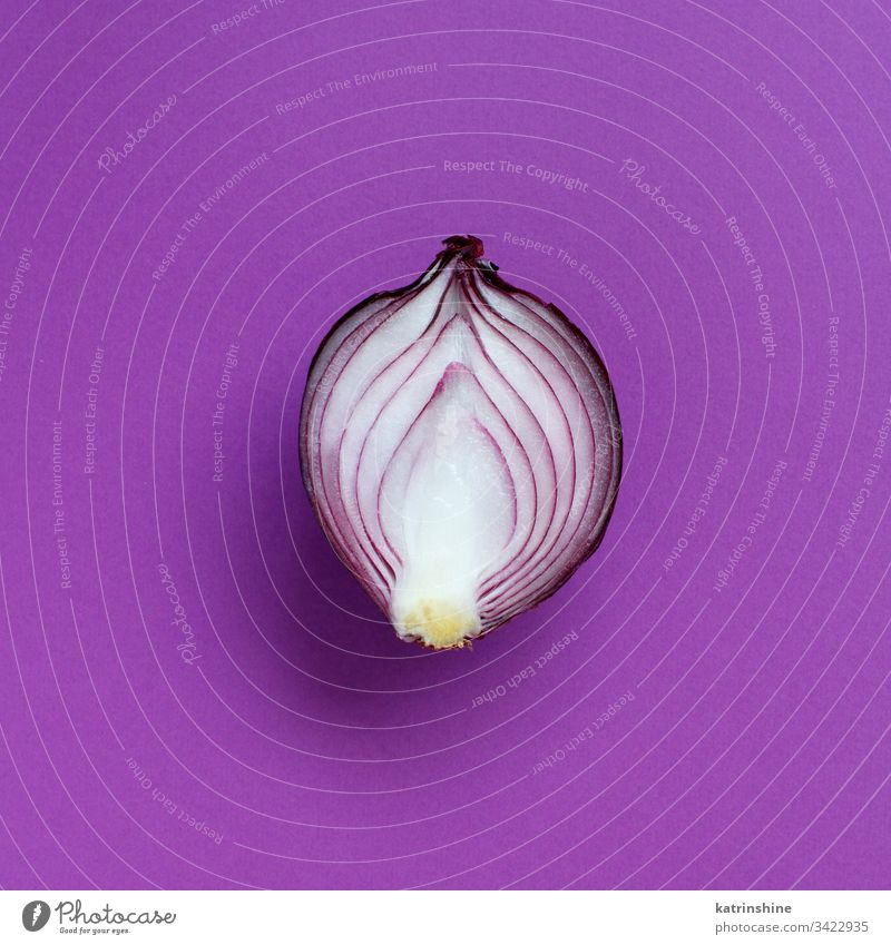 Purple onion on a purple background violet top view above red sliced half food healthy monochrome raw organic vegetable ingredient vegetarian ripe vitamin