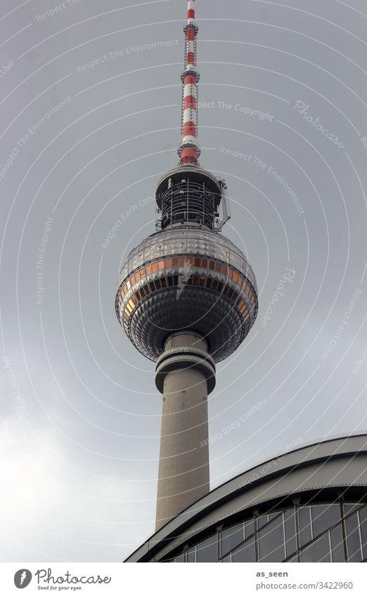 TV tower under dark clouds Berlin Television tower Tourist Attraction Berlin TV Tower Landmark Alexanderplatz Monument Downtown Berlin Sky Capital city Sphere