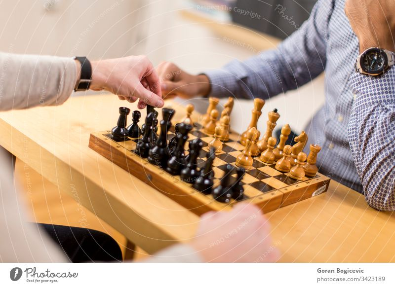 chess player Business Caucasian Chess Competition enjoying Friends game Game art Happy indoors savvy free time Lifestyle masculine men people Piece Playing