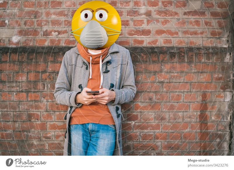 Emoji head wearing face protective mask. business calling casual cell cellphone city communication device emoji emojis happy internet lifestyle looking message
