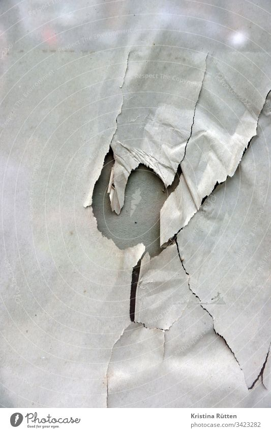 paper with hole behind glass pane Paper Wrapping paper Torn Crack & Rip & Tear cracks Broken Hollow Slice Window Shop window reflection structure texture