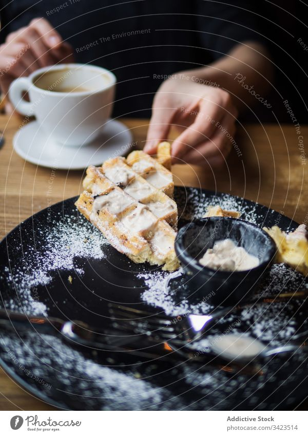 Crop person drinking coffee after ice cream and waffle cafe eat cut sweet table sit fork knife delicious food tasty dessert fresh plate restaurant breakfast