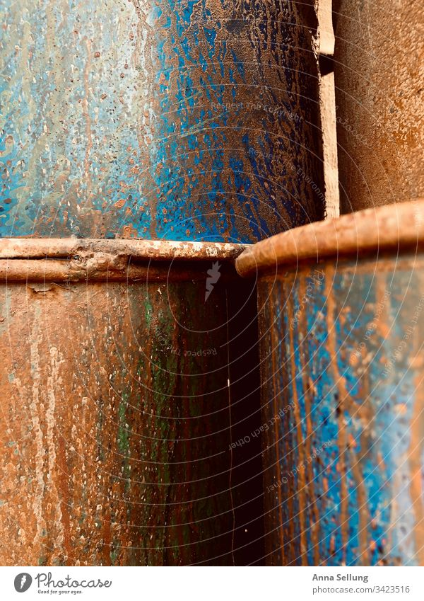 Rusty stacked metal barrels Abstract Obscure Structures and shapes Close-up Multicoloured Pattern Detail Background picture Exceptional Design Deserted