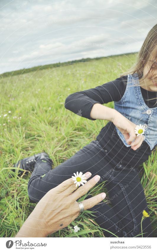 mother and daughter in green with ring of flowers Child Girl hands Hand Fingers Infancy Exterior shot Playing out Leisure and hobbies Spring Nature Ring Flower