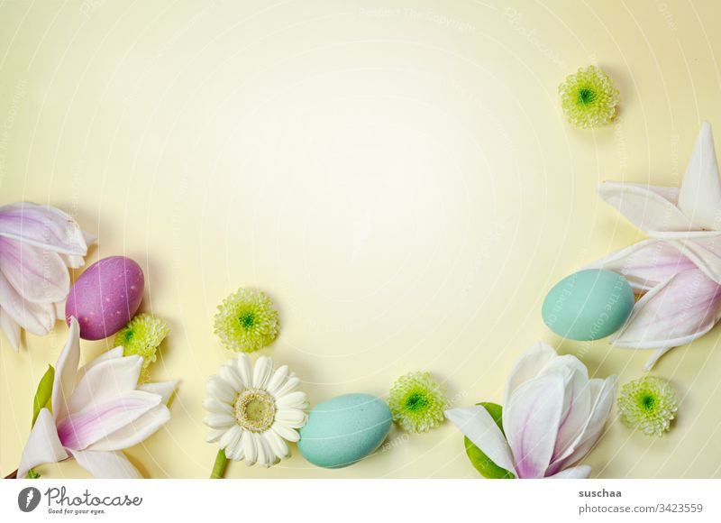 easter eggs and spring decoration on yellow background Easter Easter eggs boiled eggs colorful eggs flowers Blossom Aster asterisk flower petals Spring Food