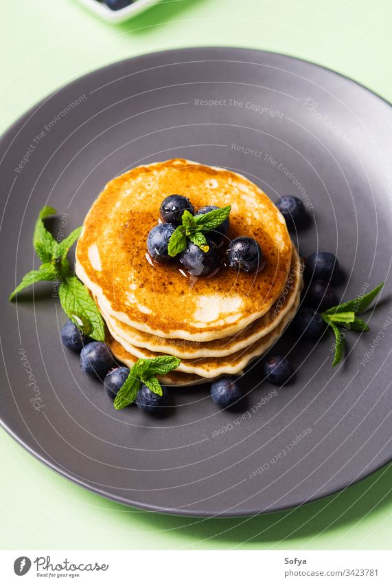 Stack of home made pancakes with fresh berries stack breakfast delicious american nobody nutrition nutritious pastel pastry pile mint plate portion recipe