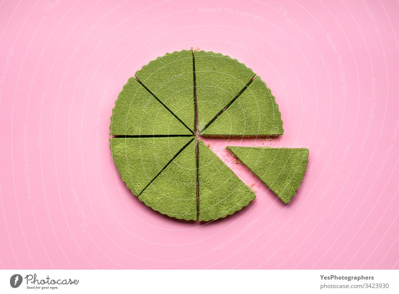 Sliced cheesecake made with matcha.  Healthy green dessert above view cheesecake tart colorful confectionery creamy delicious flat lay food green cheesecake