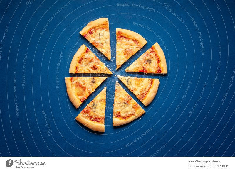 Sliced pizza on blue background. 4 cheese pizza slices Italian above view carbohydrates carbs classic blue crust cuisine dinner european famous fast food