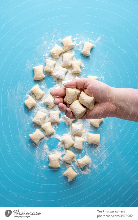 Gnocchi dumplings uncooked. Cheese gnocchi in hand Italian above view blue cheese cooking cuisine diet dinner european flat lay flour food fresh gastronomy
