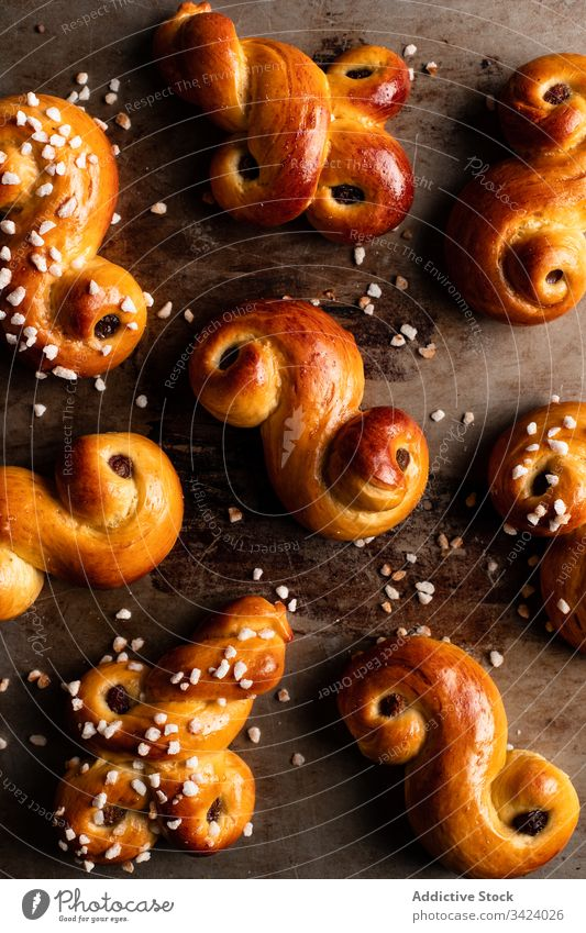 Appetizing sweet buns on wooden table food bake homemade tasty pastry curl yummy fresh saffron tradition nutrition appetizing eat cook culinary gastronomy