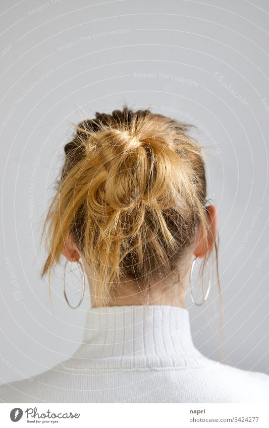 Untidy hairstyle of a blonde young woman from behind. Young woman Blonde Chignon Hair and hairstyles long hairs Disheveled Youth (Young adults) Anonymous Nape