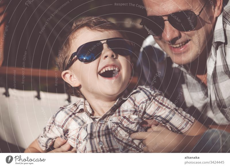 Father and son playing in the park at the day time. father dad outdoor field kid man adventure leisure fly fun activity travel dream boy sunrise camp holiday