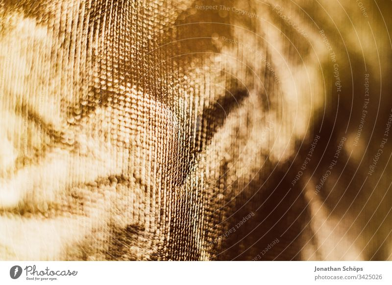 Texture of shiny gold background foil bright close up glamorous glaring glossy golden lustrous material nacreous photographic equipment shine sparkle texture
