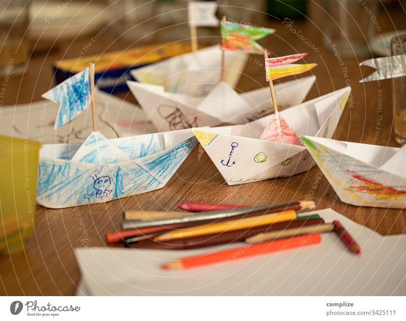Paper ships made and painted by children Parenting Kindergarten kita Paper boat Handicraft pencil box pens Painting (action, artwork) Draw Creativity creatively