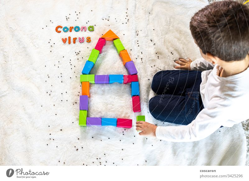 Little kid playing and understanding wath the coronavirus is blocks caucasian child children city concept confined confinement contagious copy space covid19