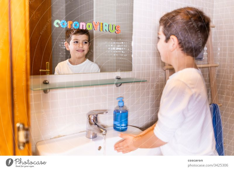 Little kid washing hands. Coronavirus concept. 2019-ncov alcohol bacteria child clean clean up corona corona virus coronavirus covid-19 cute dirty disease face