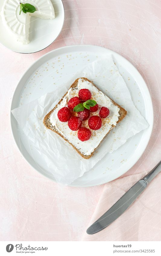 Toasted bread with fresh cheese and strawberries slice strawberry delicious food healthy breakfast lunch gourmet sandwich meal toast fruit sweet from above
