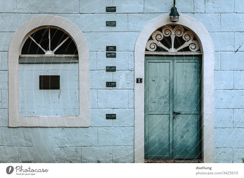 Weathered facade with turquoise door Facade House (Residential Structure) Window Arrangement Deserted Architecture Exterior shot Abstract Esthetic Building