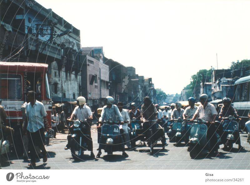 Street scene 2 Transport India Delhi Scooter Traffic regulation Helmet look to the right