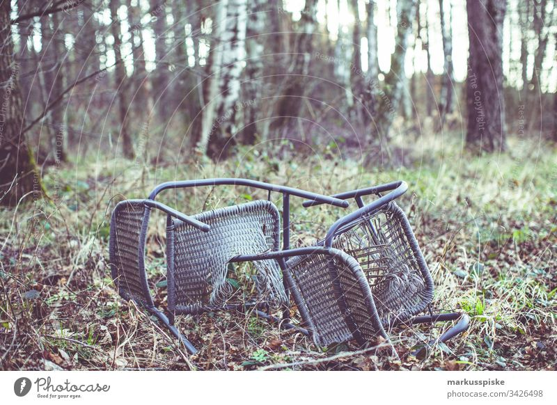 Illegal waste disposal in the forest illicit Waste management Forest punishable Penalty Chair chairs Broken Disposal Environmental pollution Perpetrator