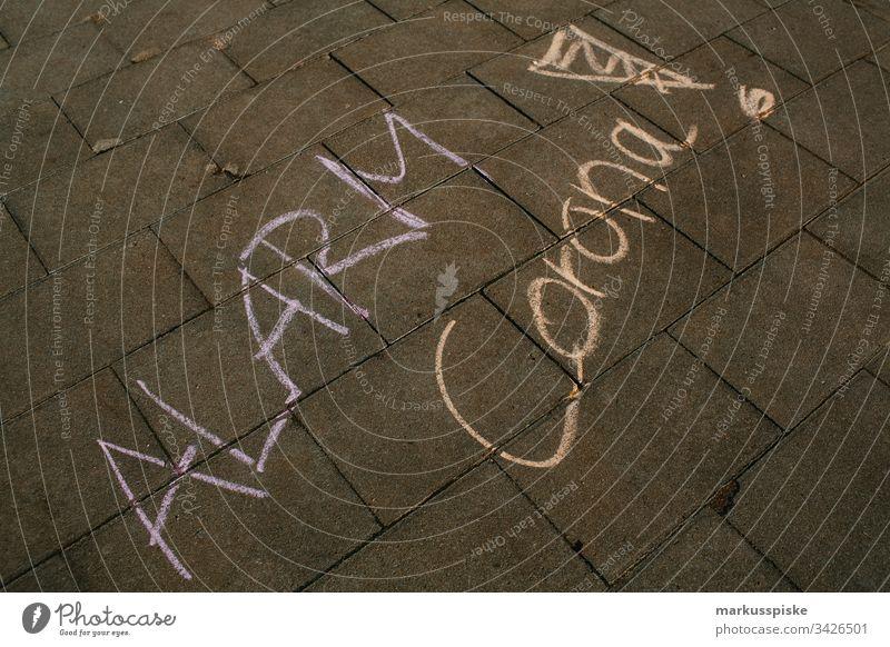 Symbolic chalk painting ALARM CORONA Alarm Dangerous Virus Corona virus coronavirus coronavirus SARS-CoV-2 corona crisis symbolic Chalk drawing