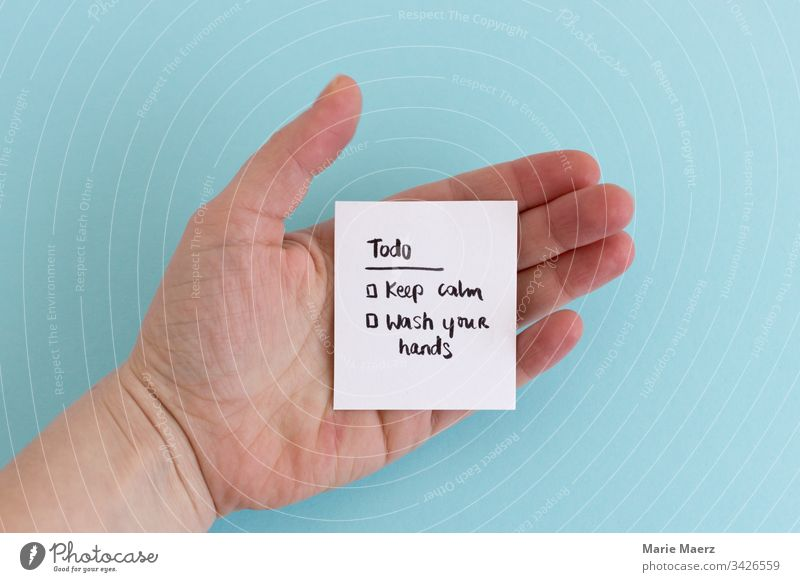 Todo: Keep calm & wash your hands | Hand holding a todo list during coronavirus crisis keep calm wash hands hygiene sign paper Personal hygiene Clean Healthy