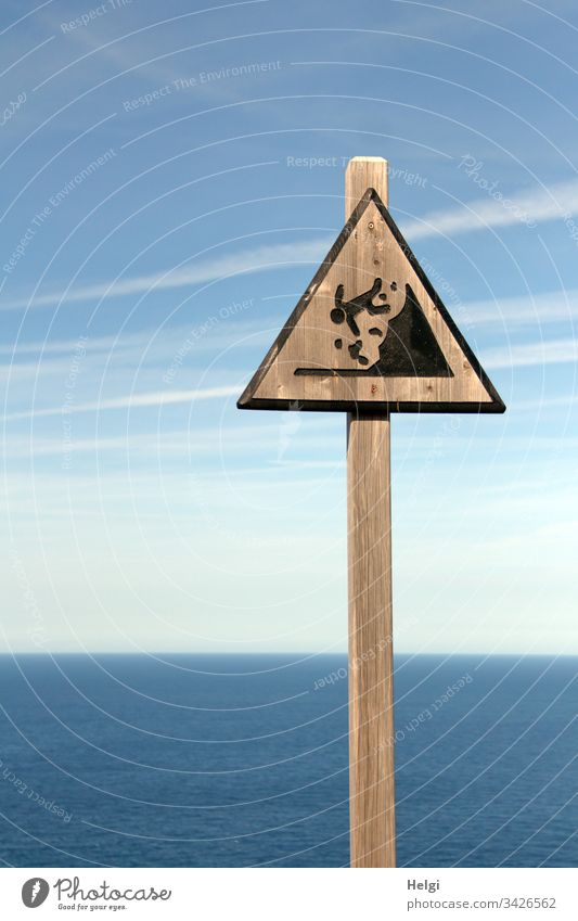 "Warning sign ""Falling hazard"" made of wood on a steep coast on Mallorca Signs and labeling Colour photo Characters Exterior shot Deserted Day Copy Space left"