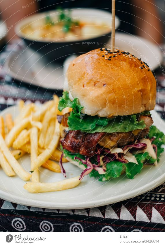 A delicious burger with fries on a plate; fast food Hamburger Restaurant Delicious frich Fast food Lunch Meal Eating Fresh Food Unhealthy Meat Colour photo Beef