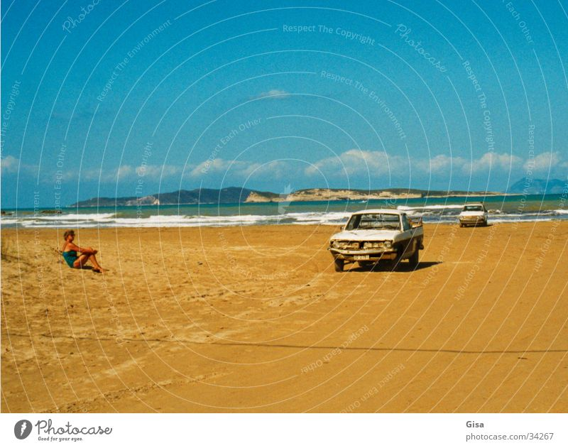 Woman Ocean Far-off places Relaxation Coast Car Blue sky Atlantic Ocean Pick-up truck Motor vehicle Sandy beach New York