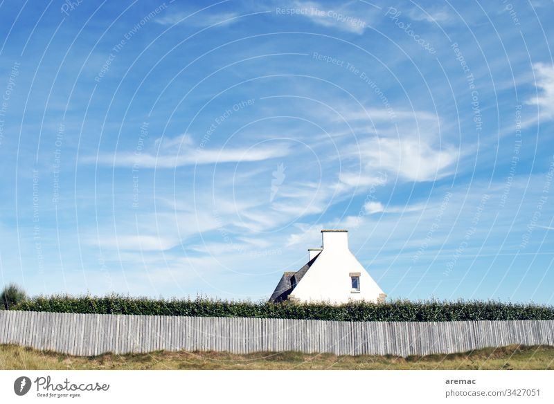 House in Brittany in France House (Residential Structure) Characteristic Manmade structures Fence Architecture Hedge Sky Blue White pediment