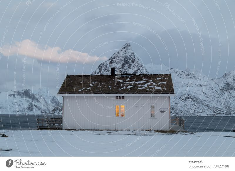 """Small white house by the fjord in front of snow-covered mountains sacrisoy Lofoten,"""" Lofoten Islands Travel photography Detached house Idyll Vacation home"""