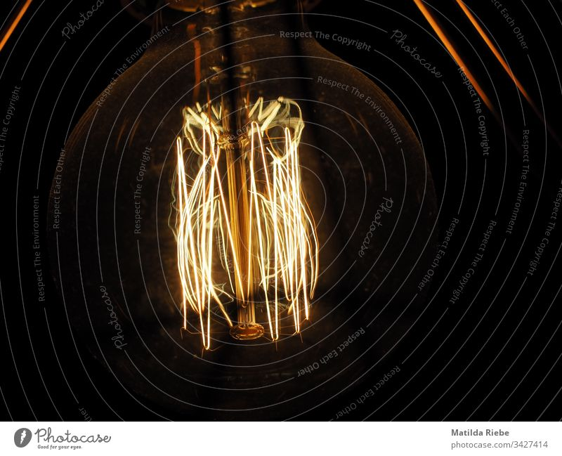 Light bulb in the dark Glow Incandescent Lamp Abstract Dark Electric bulb Technology Energy Force Idea Creativity Design Symbols and metaphors Electricity