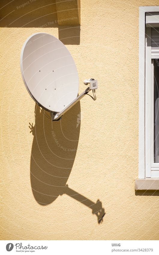 Satellite dish on house wall Satellite Dish Receive transfer Antenna bowl satellite reception Radio medium news entertainment Radio (broadcasting) TV technology
