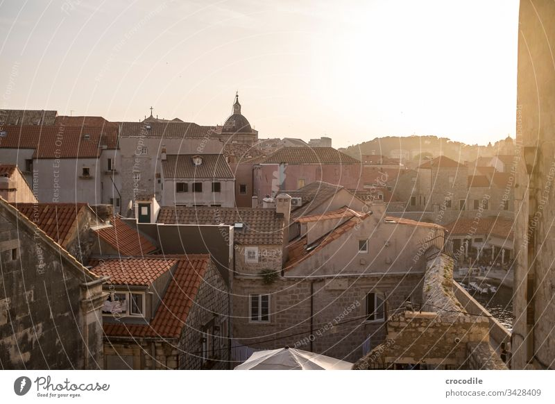 Dubrovnik Old Town Croatia Tourism Old town Wall (barrier) Fortress Ocean Coast World heritage houses Historic Buildings sunset Back-light Mediterranean
