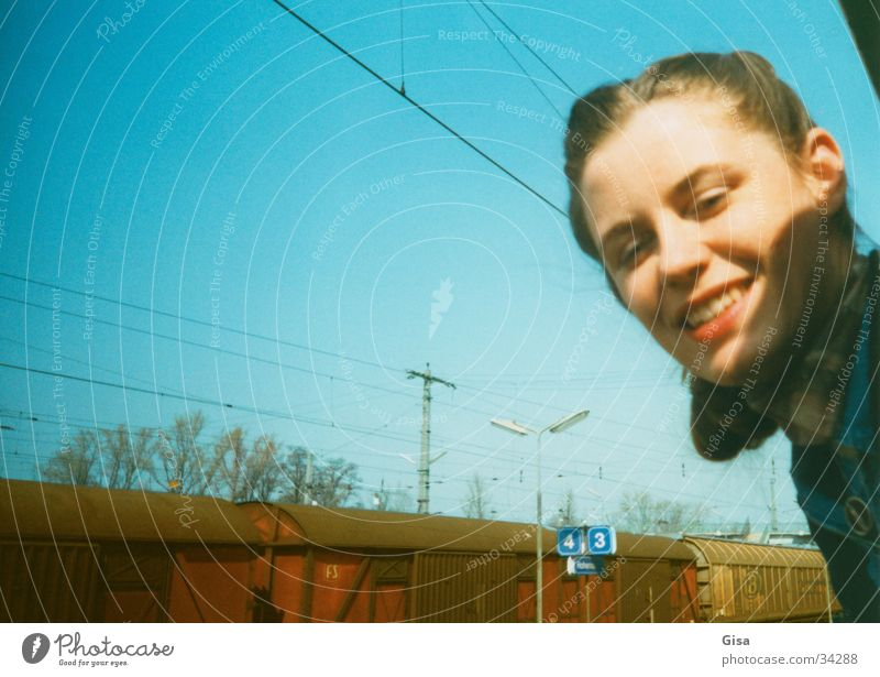 Woman Sky Joy Face Vacation & Travel Window Laughter Railroad Europe Target Station Train station Portrait photograph Come East