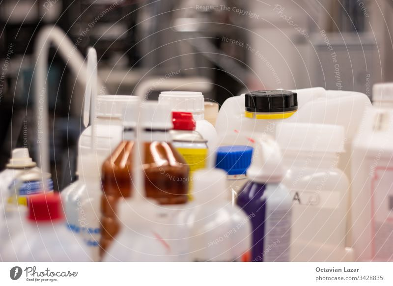 Various plastic bottle chemical containers in a science laboratory group shot shallow depth of field transparent isopropyl industrial molecular experiment flask