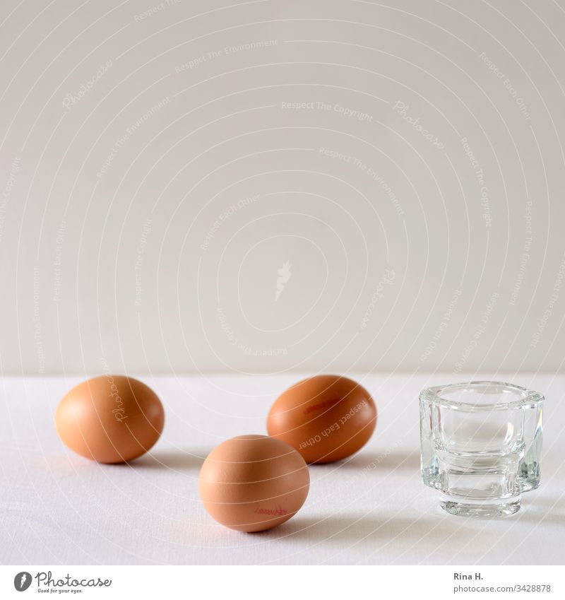Three brown eggs and an egg cup Egg cup Easter minimalism Easter egg Breakfast Colour photo boiled eggs Food Interior shot Deserted