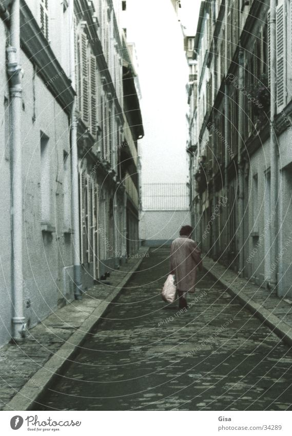 An old woman in Paris Loneliness No through road Town Woman Old End Lanes & trails Street Death